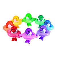 Tomy Игрушка для ванной До-ре-ми Поющие дельфины 6528