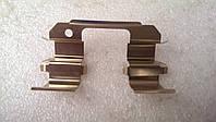 Пружина прижимная передних колодок Ланос (OE)
