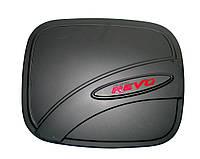 Toyota Hilux Revo 2014 накладка черная на лючек бензобака