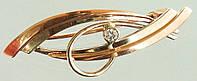 Золота брошка з цирконом