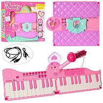 Синтезатор - орган для дівчинки рожевий, складаний сумочка - валіза.