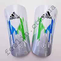 Щитки футбольные Adidas champions league серые