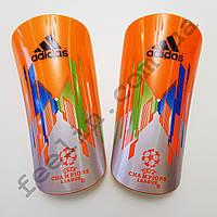 Щитки футбольные Adidas champions league оранжевые