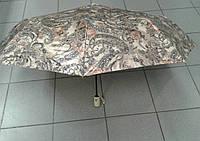 Женский зонт от дождя прочный красивый бежевого цвета.