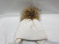 Теплая детская шапка с бумбоном из енота Dasti