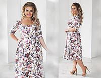 Элегантное женское платье с цветным принтом
