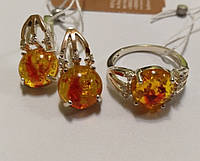 Комплект из серебра с золотыми напайками и желтым янтарем Огонек