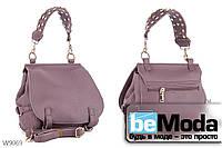 Модная и очень удобная женская сумка с качественной эко-кожи оригинального фасона и стильной ручкой фиолетовая