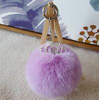 Шикарный брелок помпон с короной фиолетовый