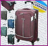 Средний Украинский чемодан на четырёх колёсах