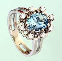Золотий перстень  з діамантом та топазом