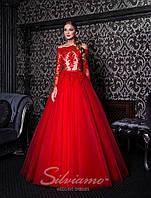 Вечернее платье с открытыми плечами, длинными рукавами и пышной юбкой-шлейф