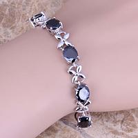 Женский серебряный браслет с сапфиром и топазом
