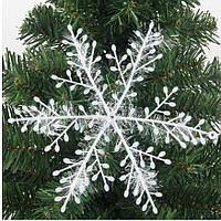 Комплект из 6 воздушных снежинок с блестками.