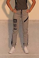 Женские спортивные брюки Reebok 7069-1 серые код 0008 Б