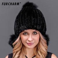 Женская норковая шапка с бубонами из лисы чёрная, фото 1