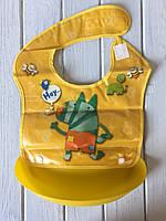 Слюнявчик с силиконовым ковшом желтый, фото 1