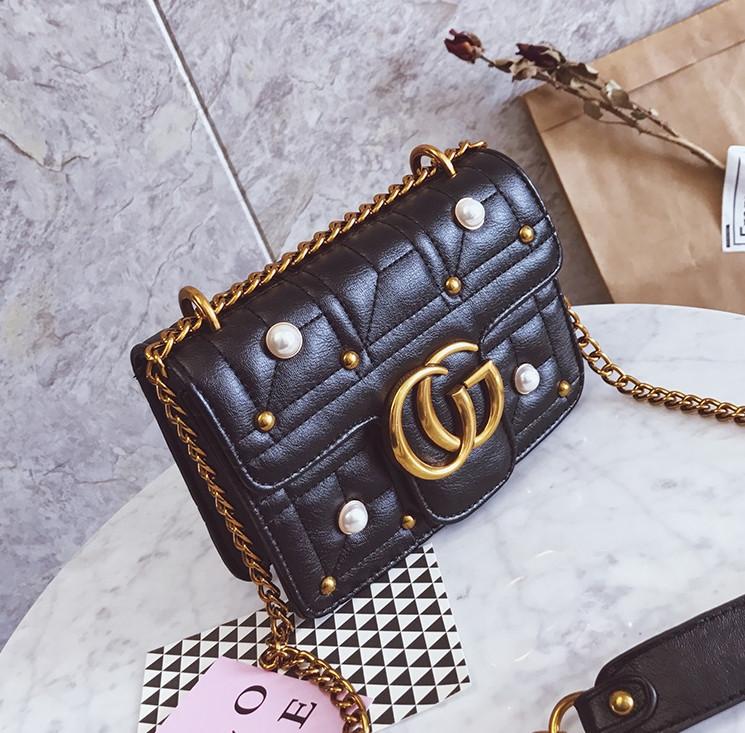 Новинка! Стильная женская сумка Gucci GG Marmont с бусинками черного цвета abf81617636