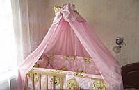 Красивый розовый балдахин для детской кроватки. Шифон