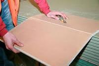 Гипсокартоные и деревянные плиты для строительства.