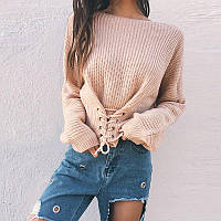 Красивый вязаный женский свитер со шнуровкой