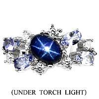 Серебряное кольцо с звёздчатым сапфиром и танзанитами