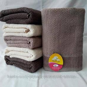 Банное  полотенце из махры с жаккардовым плетением . Размер 140*70.