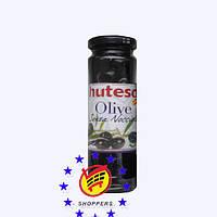 Черные оливки без косточки Hutesa 140г