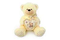 Мягкая игрушка Мишка с сердечком музыкальный 6396\60 сидячий 60 см, молочный