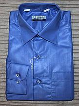 Рубашка для мальчика цветная синяя полированная.