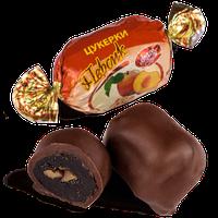 Шоколадные конфеты Персик в черном шоколаде с грецким орехом Skava