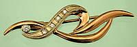Золота брошка з діамантом