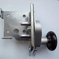 Кронштейн нижний с роликом RBG100R для ворот Alutech