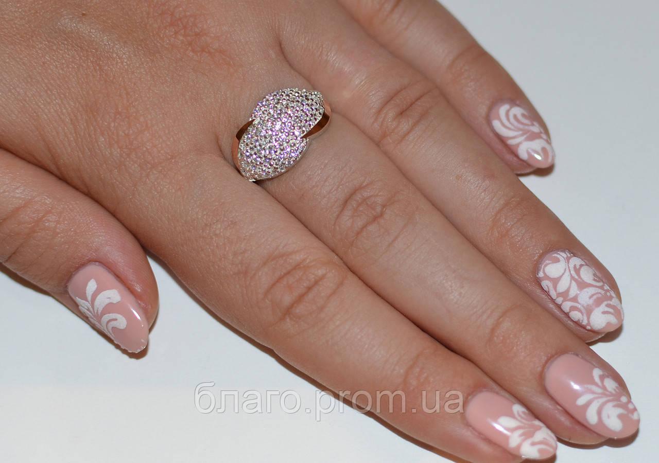Шикарное серебряное кольцо с золотыми вставками