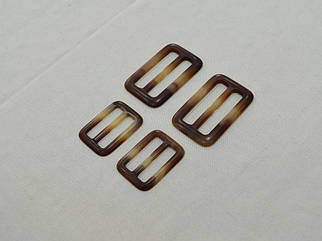 Пряжка коричневая матовая арт. 25049, цена за упаковку 50шт.