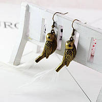 Стильные женские серьги в форме птиц бронзового цвета от TOPSHOP