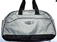 Женская большая серая дорожная сумка из текстиля с черными ручками 42*27