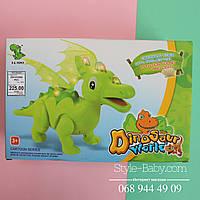 Игрушка Динозавр звук - рычит, свет, ходит, проектор, на батарейке в коробке 31*20*11 см