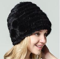 Меховая женская шапка из вязанной норки по спирали с цветами черная