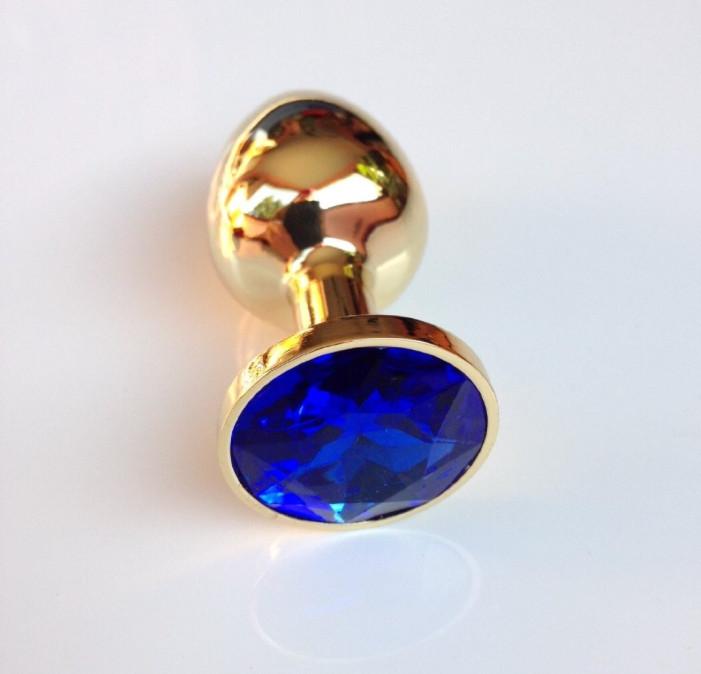 Золотая анальная пробка с синим кристаллом в чехле 2.8*7 см Металлическая