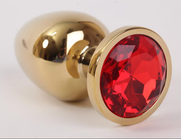 Золотая анальная пробка с красным кристаллом в чехле 2.8*7 см Металлическая