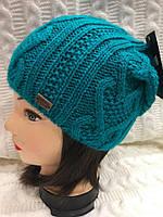 Женская зимняя вязанная шапка.