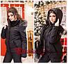 Женский черный зимний лыжный костюм-комбинезон.