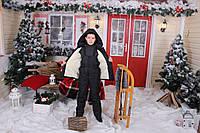Подростковый черный зимний лыжный костюм-комбинезон.