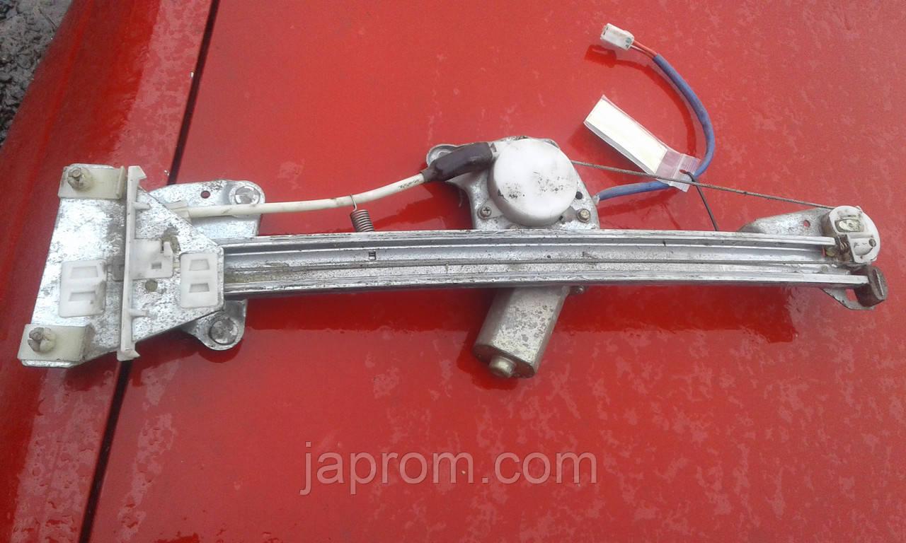 Стеклоподъемник передний правый электрический Mazda 626 GF хетч, седан 2000-02 г.в