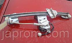 Стеклоподъемник передний левый электрический Mazda 626 GF комби 2000-02 г.в