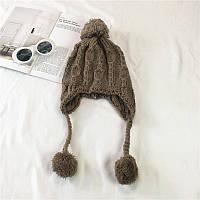 Стильная теплая женская шапка ушанка с бамбонами коричневого цвета