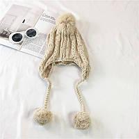 Стильная теплая женская шапка ушанка с бамбонами бежевого цвета
