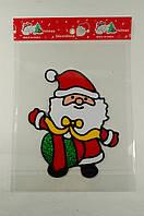 """Новогодняя силиконовая наклейка """"Санта с подарком"""" 15х20 см, 12 шт/пачка"""