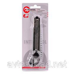 Нож с ломающимся лезвием 18мм, с металлической направляющей, противоскользящий корпус, с винтовой фиксацией лезвия. INTERTOOL HT-0507